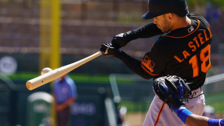 Mar 21, 2021; Phoenix, Arizona, USA; SF Giants infielder Tommy La Stella (18) hits a single in the third against the Los Angeles Dodgers during a Spring Training game at Camelback Ranch, Glendale. (Allan Henry-USA TODAY Sports)