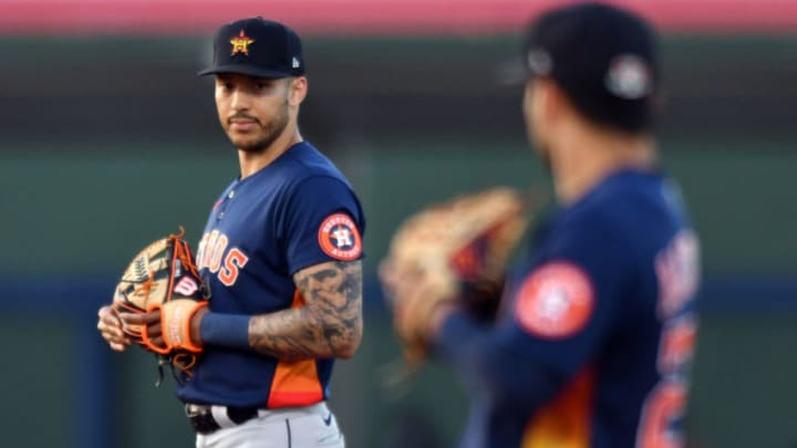 Houston Astros shortstop Carlos Correa (1) looks over at teammate second baseman Jose Altuve (27) in the second inning during a spring training game against the Washington Nationals at Ballpark of the Palm Beaches. (Jim Rassol-USA TODAY Sports)