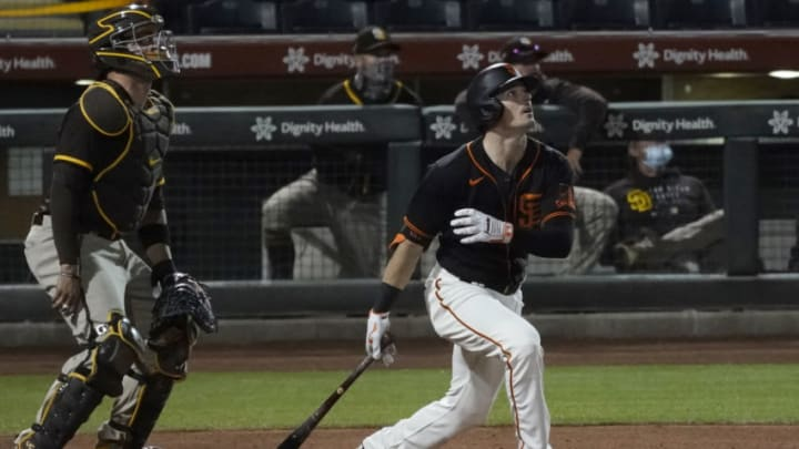 Mar 24, 2021; Scottsdale, Arizona, USA; SF Giants right fielder Mike Yastrzemski (5) hits a homerun against the San Diego Padres during a spring training game at Scottsdale Stadium. (Rick Scuteri-USA TODAY Sports)