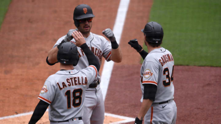 SF Giants right fielder Mike Tauchman (C) is greeted at home plate by second baseman Tommy La Stella (18) and starting pitcher Kevin Gausman (34) after hitting a three-run home run against the San Diego Padres during the third inning at Petco Park. (Orlando Ramirez-USA TODAY Sports)