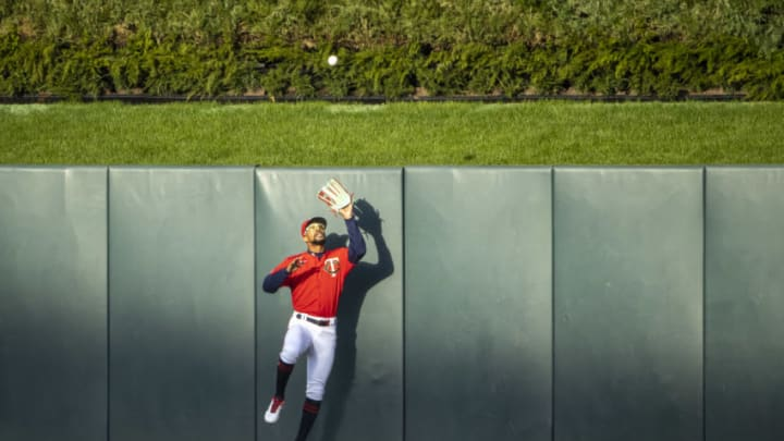 May 4, 2021; Minneapolis, Minnesota, USA; Minnesota Twins center fielder Byron Buxton (25) jumps up and catches a fly ball in the first inning against the Texas Rangers at Target Field. Mandatory Credit: Jesse Johnson-USA TODAY Sports