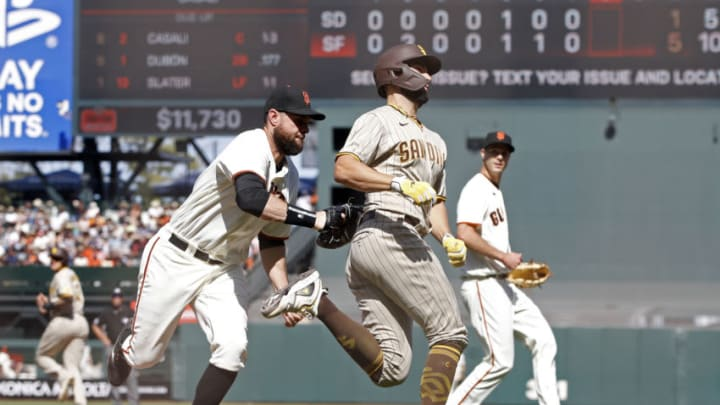 SF Giants first baseman Brandon Belt (9) tags out San Diego Padres first baseman Eric Hosmer (30) during the eighth inning at Oracle Park. (Darren Yamashita-USA TODAY Sports)