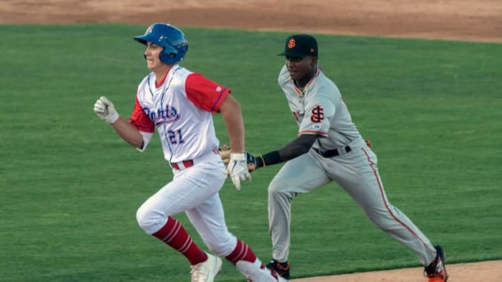 (5/11/21) Stockton Ports' Tyler Soderstrom left, is chased by SF Giants prospect Marco Luciano after Soderstrom overran first while trying to stretch a single into a double during a California League baseball game at the Stockton Ballpark in downtown Stockton. Soderstrom was out on the play but advanced a runner to third. (CLIFFORD OTO/THE STOCKTON RECORD)