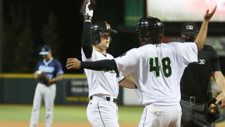 Eugene Emeralds Will Wilson (center) celebrates his 8th inning home run with Frank Labour at PK Park in Eugene.