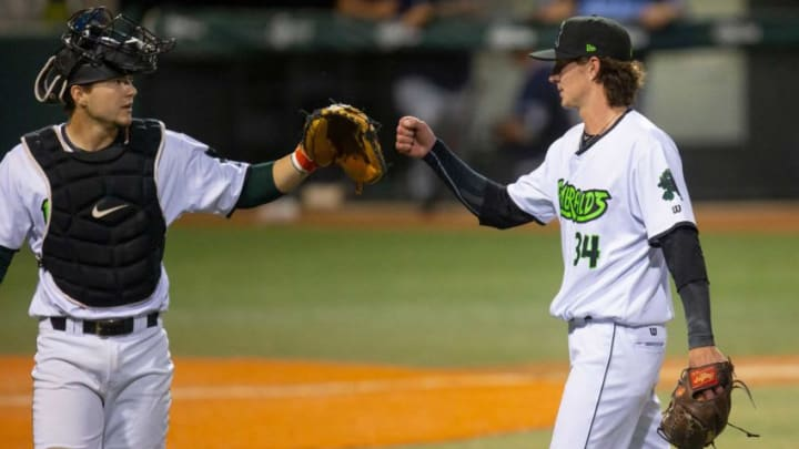Eugene Emeralds catcher Patrick Bailey, left, congratulates pitcher Travis Perry at the end of the fifth inning against the Hillsboro Hops at PK Park in Eugene.