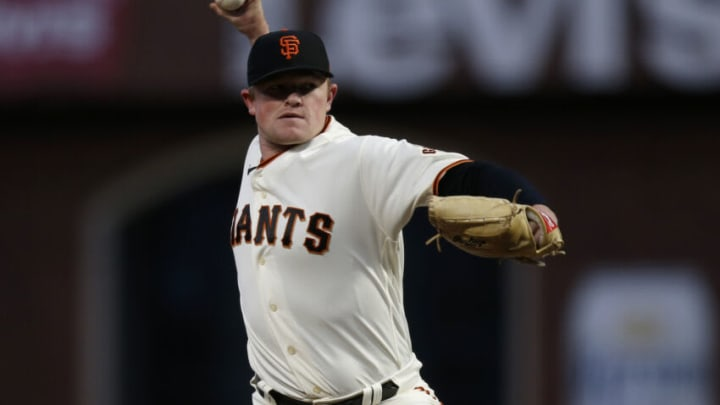 Oct 8, 2021; San Francisco, California, USA; San Francisco Giants starting pitcher Logan Webb (62) pitches in the first inning against the Los Angeles Dodgers during game one of the 2021 NLDS at Oracle Park. Mandatory Credit: D. Ross Cameron-USA TODAY Sports