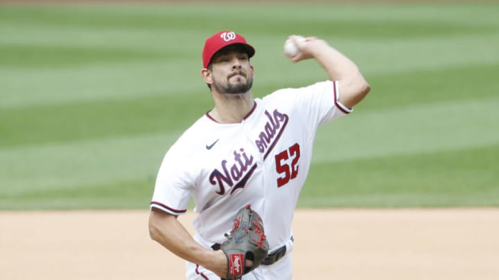 Jun 12, 2021; Washington, District of Columbia, USA; Washington Nationals relief pitcher Brad Hand (52) throws the ball against the San Francisco Giants during the seventh inning at Nationals Park. Mandatory Credit: Amber Searls-USA TODAY Sports