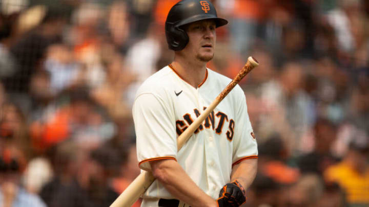 Aug 18, 2021; San Francisco, California, USA; San Francisco Giants left fielder Alex Dickerson (12) awaits his turn at bat against the New York Mets during the fifth inning at Oracle Park. Mandatory Credit: D. Ross Cameron-USA TODAY Sports