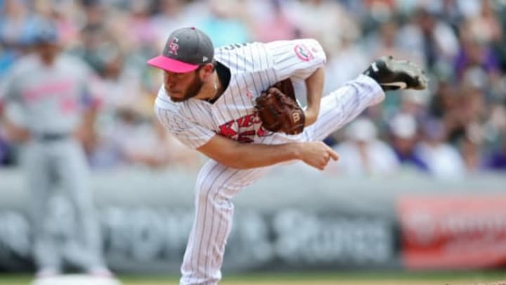 May 14, 2017; Denver, CO, USA; Colorado Rockies relief pitcher Greg Holland delivers a pitch during the ninth inning against the Los Angeles Dodgers at Coors Field. Mandatory Credit: Chris Humphreys-USA TODAY Sports