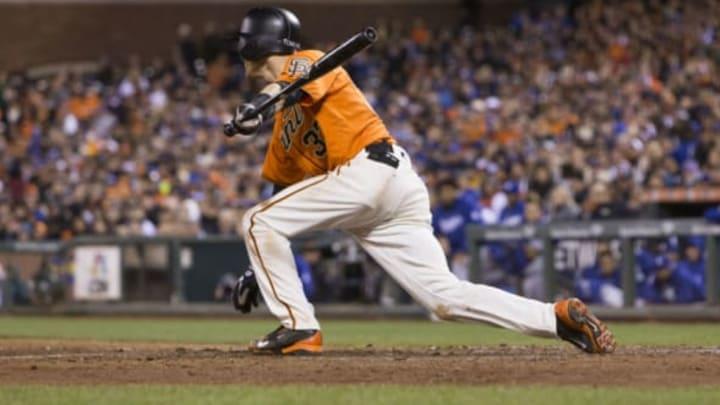 Sep 30, 2016; San Francisco, CA, USA; San Francisco Giants second baseman Kelby Tomlinson (37) singles to left field against the Los Angeles Dodgers during the sixth inning at AT&T Park. Mandatory Credit: Neville E. Guard-USA TODAY Sports