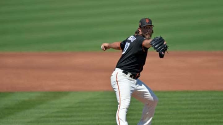 Mar 21, 2017; Scottsdale, AZ, USA; San Francisco Giants starting pitcher Madison Bumgarner (40) pitches during the first inning against the San Diego Padres at Scottsdale Stadium. Mandatory Credit: Jake Roth-USA TODAY Sports