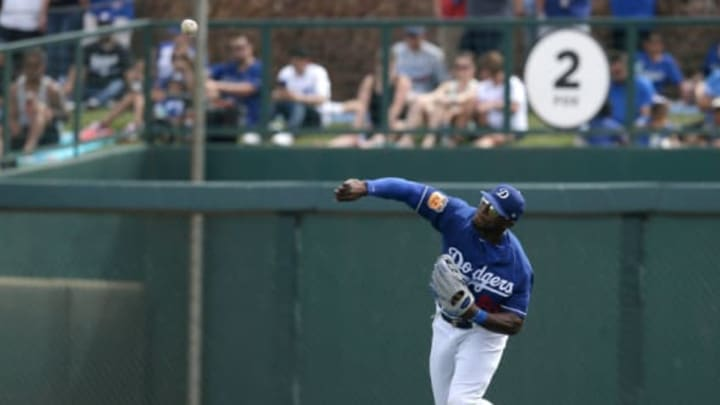 Mar 25, 2017; Phoenix, AZ, USA; Los Angeles Dodgers right fielder Yasiel Puig (66) during a spring training game against the Oakland Athletics at Camelback Ranch. Mandatory Credit: Rick Scuteri-USA TODAY Sports