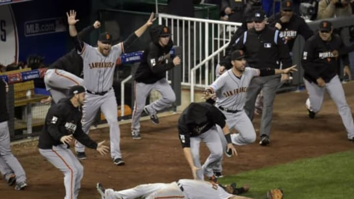 Oct 29, 2014; Kansas City, MO, USA; San Francisco Giants third baseman Pablo Sandoval (bottom) celebrates with teammates after catching a pop out for the final out of game seven of the 2014 World Series against the Kansas City Royals at Kauffman Stadium. Mandatory Credit: Denny Medley-USA TODAY Sports