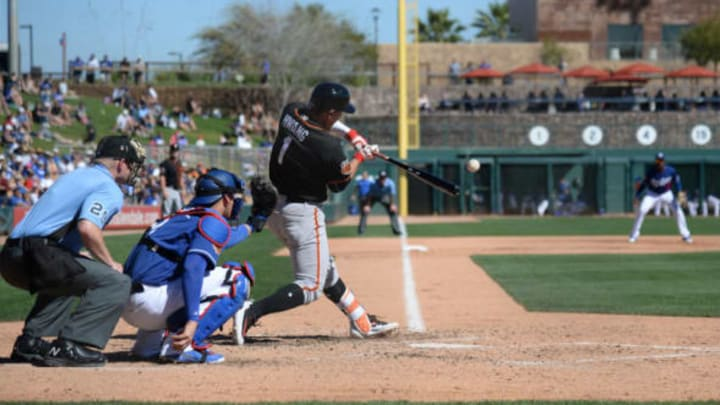 Mar 7, 2017; Phoenix, AZ, USA; San Francisco Giants third baseman Jae-Gyun Hwang (1) hits a home run against the Los Angeles Dodgers during the fifth inning at Camelback Ranch. Mandatory Credit: Joe Camporeale-USA TODAY Sports