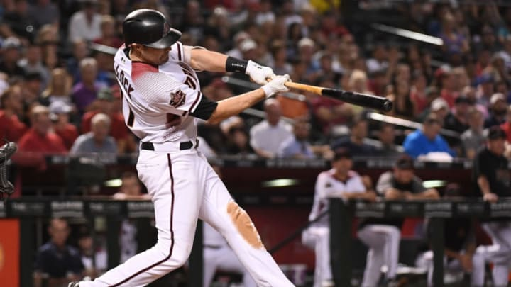 PHOENIX, AZ - SEPTEMBER 26: A.J. Pollock #11 of the Arizona Diamondbacks hits a three-run home run in the fifth inning of the MLB game against the Los Angeles Dodgers at Chase Field on September 26, 2018 in Phoenix, Arizona. (Photo by Jennifer Stewart/Getty Images)