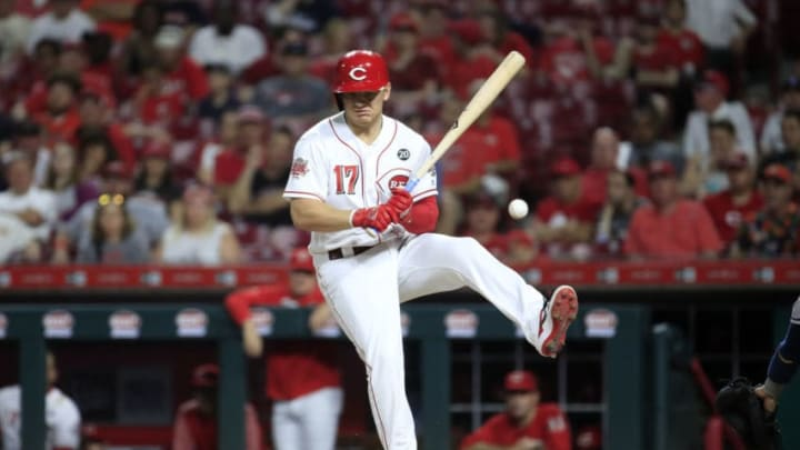CINCINNATI, OHIO - JUNE 18: Josh VanMeter #17 of the Cincinnati Reds is hit by a pitch in the 8th inning against the Houston Astros at Great American Ball Park on June 18, 2019 in Cincinnati, Ohio. (Photo by Andy Lyons/Getty Images)