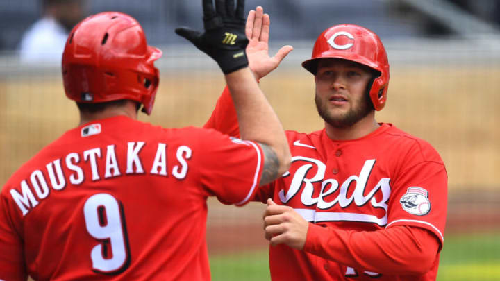 PITTSBURGH, PA - MAY 12: Nick Senzel #15 of the Cincinnati Reds celebrate with Mike Moustakas #9 after scoring. (Photo by Joe Sargent/Getty Images)