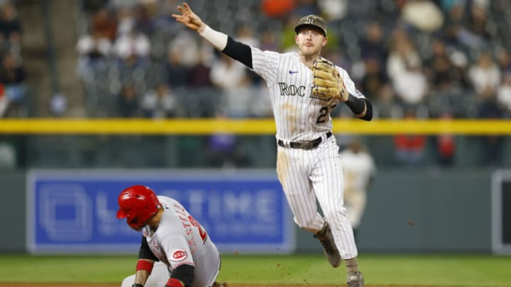 DENVER, CO - MAY 15: Trevor Story #27 of the Colorado Rockies throws to first base to complete the double play as Nick Castellanos #2 of the Cincinnati Reds slides. (Photo by Justin Edmonds/Getty Images)