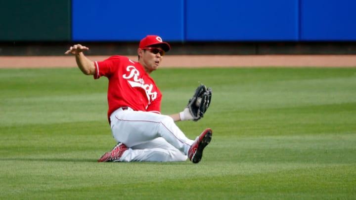 CINCINNATI, OH - AUGUST 29: Shogo Akiyama #4 of the Cincinnati Reds makes a sliding catch. (Photo by Kirk Irwin/Getty Images)