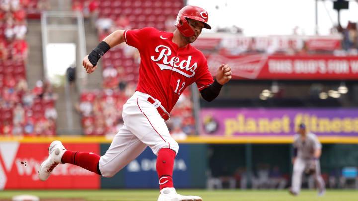 Tyler Naquin #12 of the Cincinnati Reds rounds third base.