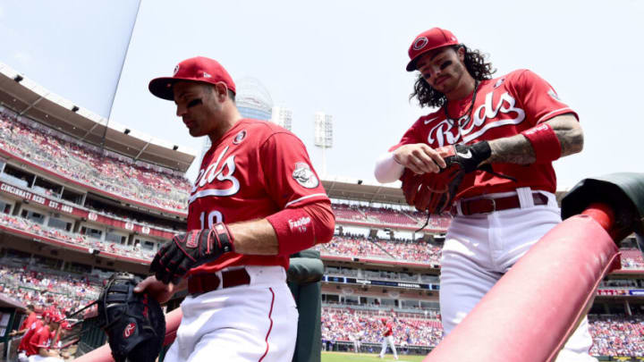 CINCINNATI, OHIO - JULY 04: Joey Votto #19 and Jonathan India #6 of the Cincinnati Reds walk off the field. (Photo by Emilee Chinn/Getty Images)