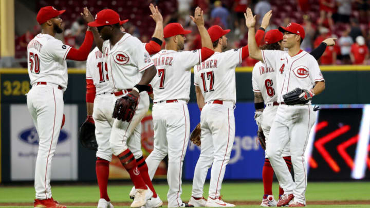 CINCINNATI, OHIO - JULY 20: The Cincinnati Reds celebrate after beating the New York Mets 4-3. (Photo by Dylan Buell/Getty Images)