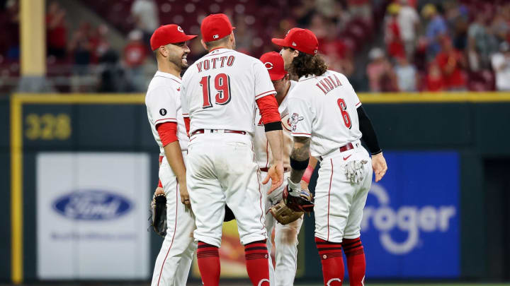 The Cincinnati Reds celebrate after beating the New York Mets.