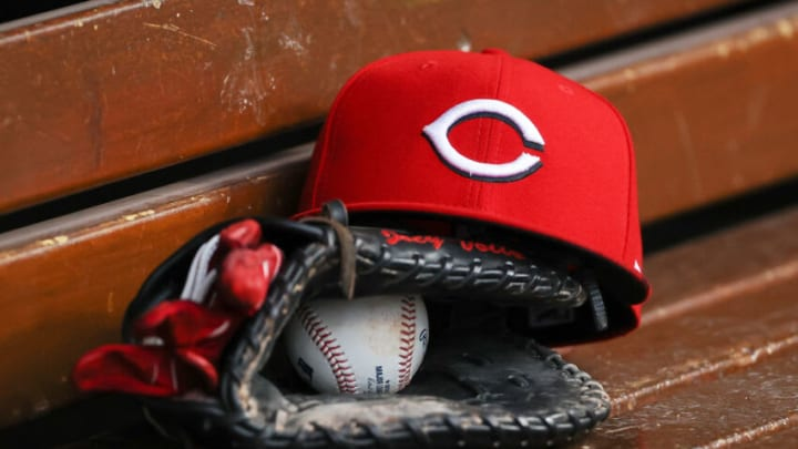 CINCINNATI, OHIO - AUGUST 30: A detail view of a Cincinnati Reds hat in the dugout. (Photo by Dylan Buell/Getty Images)