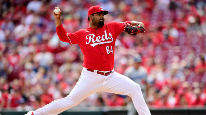 CINCINNATI, OHIO - SEPTEMBER 19: Tony Santillan #64 of the Cincinnati Reds pitches in the fourth inning. (Photo by Emilee Chinn/Getty Images)