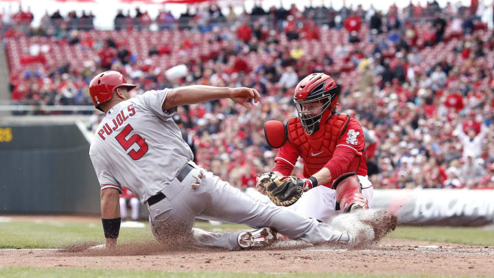 Albert Pujols #5 of the Los Angeles Angels of Anaheim slides into home ahead of the tag by Ryan Hanigan #29 of the Cincinnati Reds during the third inning.