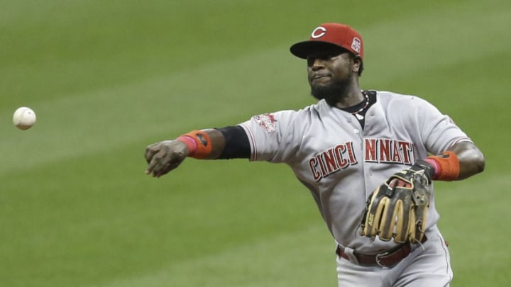 MILWAUKEE, WI - SEPTEMBER 18: Brandon Phillips #4 of the Cincinnati Reds makes the throw to first base to retire Jean Segura of the Milwaukee Brewers in the third inning at Miller Park on September 18, 2015 in Milwaukee, Wisconsin. (Photo by Mike McGinnis/Getty Images)
