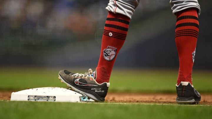 MILWAUKEE, WI - APRIL 17: Joey Votto #19 of the Cincinnati Reds wears Humboldt Broncos on his cleats during a game against the Milwaukee Brewers at Miller Park on April 17, 2018 in Milwaukee, Wisconsin. (Photo by Stacy Revere/Getty Images)