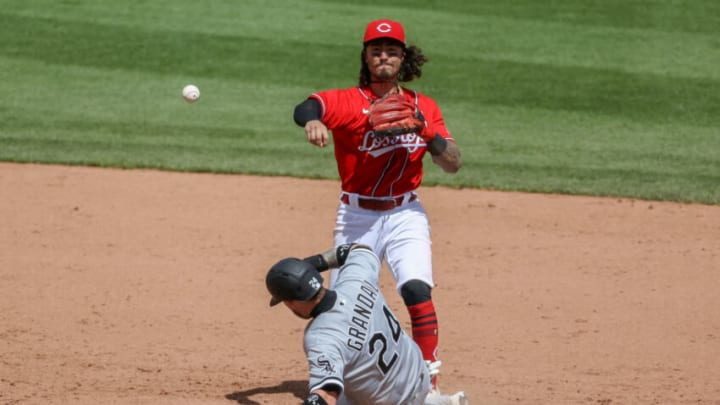 CINCINNATI, OHIO - MAY 05: Jonathan India #6 of the Cincinnati Reds attempts to turn a double play past Yasmani Grandal #24 of the Chicago White Sox in the tenth inning at Great American Ball Park on May 05, 2021 in Cincinnati, Ohio. (Photo by Dylan Buell/Getty Images)