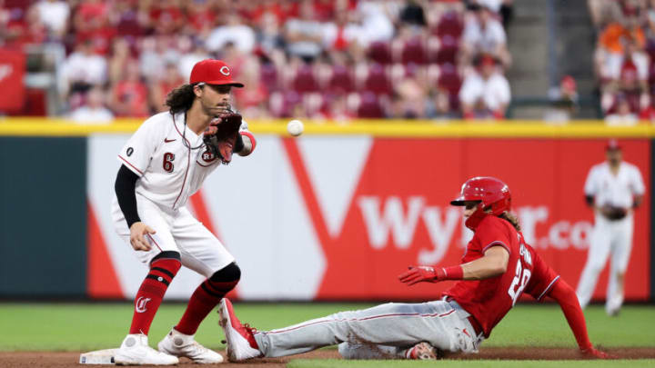 CINCINNATI, OHIO - JUNE 28: Alec Bohm #28 of the Philadelphia Phillies steals second base past Jonathan India #6 of the Cincinnati Reds. (Photo by Dylan Buell/Getty Images)