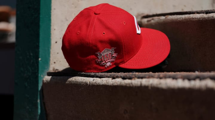 A view of the 150th Anniversary patch on a Reds' New Era baseball hat in the dugout.