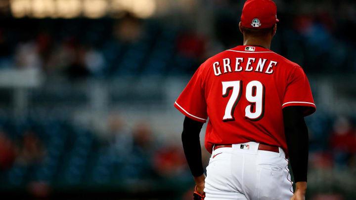 Cincinnati Reds starting pitcher Hunter Greene (79) returns to the dugout.