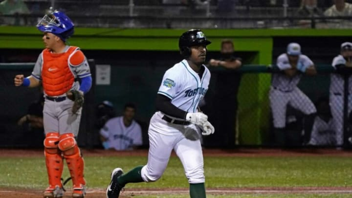 Ivan Johnson trots to first after getting hit with the ball during Tortugas opener at Jackie Robinson Ballpark.
