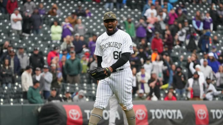 May 16, 2021; Denver, Colorado, USA; Colorado Rockies relief pitcher Mychal Givens (60) reacts to his bases on ball call in the ninth inning against the Cincinnati Reds. Mandatory Credit: Ron Chenoy-USA TODAY Sports