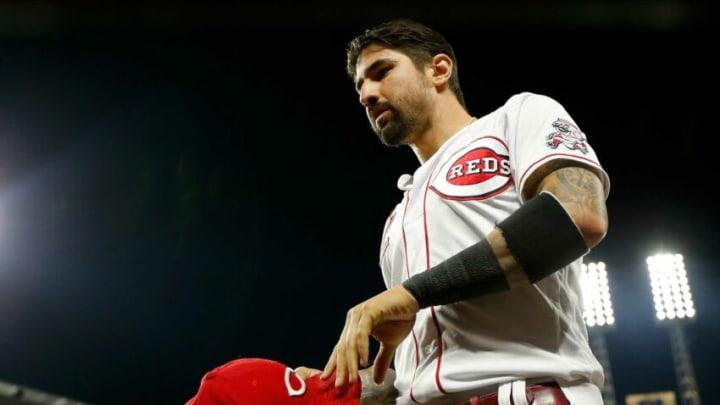 Cincinnati Reds right fielder Nick Castellanos (2) returns to the dugout.