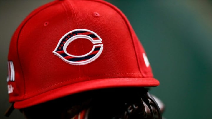 The Reds wear special hats for the 4th of July Weekend during the MLB National League game between the Cincinnati Reds and the Chicago Cubs.