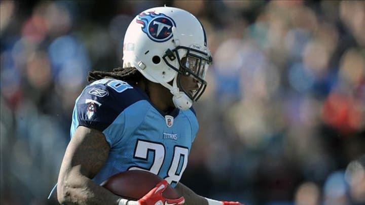 Dec 11, 2011; Nashville,TN, USA; Tennessee Titans running back Chris Johnson (28) rushes against the New Orleans Saints during the first half at LP Field. Mandatory Credit: Jim Brown-US PRESSWIRE
