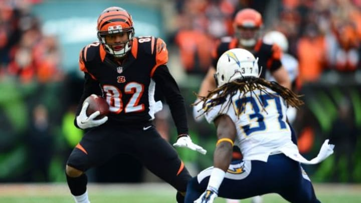 Jan 5, 2014; Cincinnati, OH, USA; Cincinnati Bengals wide receiver Marvin Jones (82) looks to get around San Diego Chargers defensive back Jahleel Addae (37) during first quarter of the AFC wild card playoff football game at Paul Brown Stadium. Mandatory Credit: Andrew Weber-USA TODAY Sports