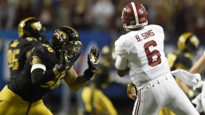 Dec 6, 2014; Atlanta, GA, USA; Missouri Tigers defensive lineman Shane Ray (56) tackles Alabama Crimson Tide quarterback Blake Sims (6) during the second quarter of the 2014 SEC Championship Game at the Georgia Dome. The play caused Ray to be ejected from the game for targeting. Mandatory Credit: Dale Zanine-USA TODAY Sports