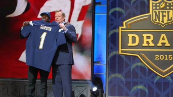 Apr 30, 2015; Chicago, IL, USA; Melvin Gordon (Wisconsin) poses for a photo with NFL commissioner Roger Goodell after being selected as the number 15th overall pick to the San Diego Chargers in the first round of the 2015 NFL Draft at the Auditorium Theatre of Roosevelt University. Mandatory Credit: Dennis Wierzbicki-USA TODAY Sports