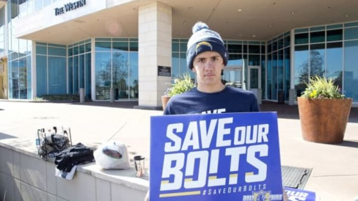 Jan 12, 2016; Houston, TX, USA; San Diego Chargers fan Richard Farley holds a sign supporting his team while owners meet at the 2016 NFL Owners meeting at the Westin Houston. Mandatory Credit: Thomas B. Shea-USA TODAY Sports