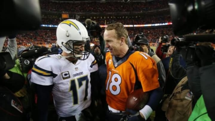 Jan 3, 2016; Denver, CO, USA; Denver Broncos quarterback Peyton Manning (18) and San Diego Chargers quarterback Philip Rivers (17) greet each other after the game at Sports Authority Field at Mile High. The Broncos won 27-20. Mandatory Credit: Chris Humphreys-USA TODAY Sports