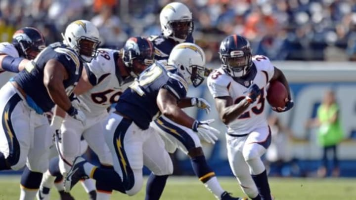 Dec 6, 2015; San Diego, CA, USA; Denver Broncos running back Ronnie Hillman (23) is defended by San Diego Chargers inside linebacker Denzel Perryman (52) on a first quarter run at Qualcomm Stadium. Mandatory Credit: Jake Roth-USA TODAY Sports