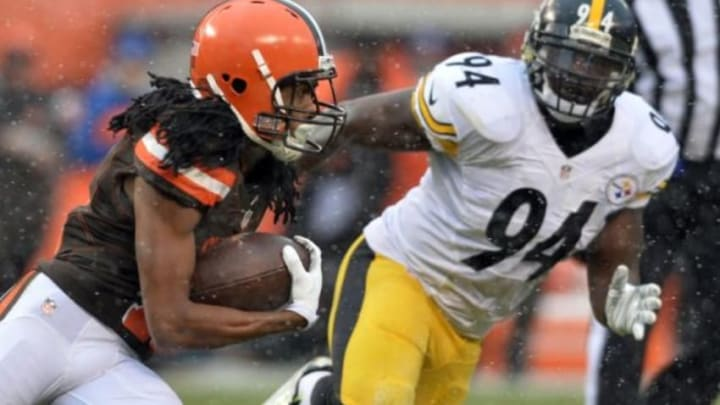 Jan 3, 2016; Cleveland, OH, USA; Cleveland Browns wide receiver Travis Benjamin (11) runs the ball as Pittsburgh Steelers inside linebacker Lawrence Timmons (94) pursues during the second quarter at FirstEnergy Stadium. Mandatory Credit: Ken Blaze-USA TODAY Sports