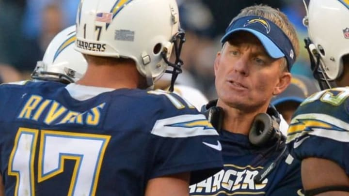 Dec 20, 2015; San Diego, CA, USA; San Diego Chargers head coach Mike McCoy talks with San Diego Chargers quarterback Philip Rivers (17) in the fourth quarter of the game against the Miami Dolphins at Qualcomm Stadium. Chargers won 30-14. Mandatory Credit: Jayne Kamin-Oncea-USA TODAY Sports