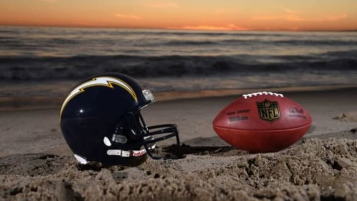 Feb 16, 2016; Los Angeles, CA, USA; General view of San Diego Chargers navy blue helmet (1988-2006) and NFL Wilson Duke football at Santa Monica State Beach. NFL owners voted 30-2 to allow Rams owner Stan Kroenke (not pictured) to move the St. Louis Rams to Los Angeles for the 2016 season. Chargers owner Dean Spanos (not pictured) has an option join the Rams in Los Angeles. Mandatory Credit: Kirby Lee-USA TODAY Sports